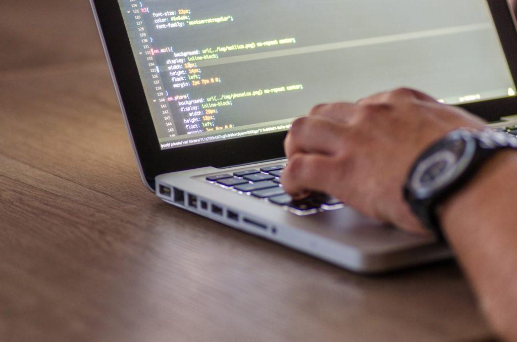 python programmer on the laptop